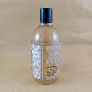 One large bottle of Soak rinse-free laundry liquid with a white label, on a tan background (Scentless)
