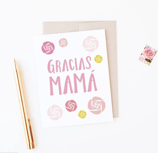 White card with various shades of flowers surrounding the words Gracias Mama.