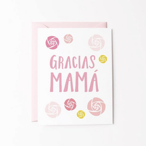White card with various shades of pink roses surrounding the words Gracias Mama written in pink. Great card for Mother's day or to thank Mom just because
