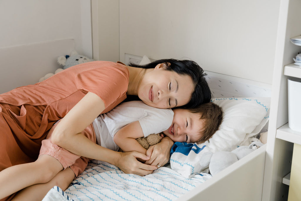 Mom hugging boy on the bed