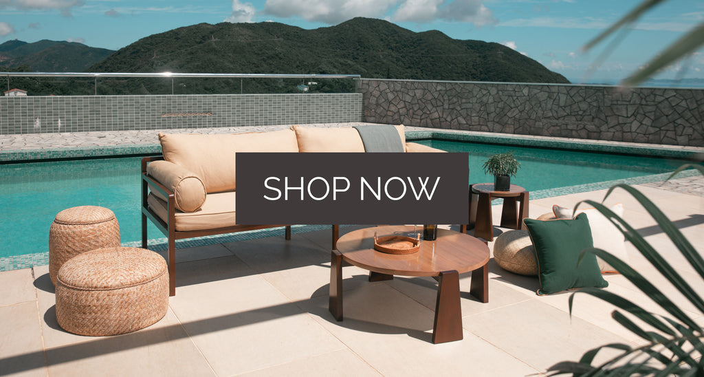 Outdoor Furniture with pool and mountain in the background. Text on top says Shop Now
