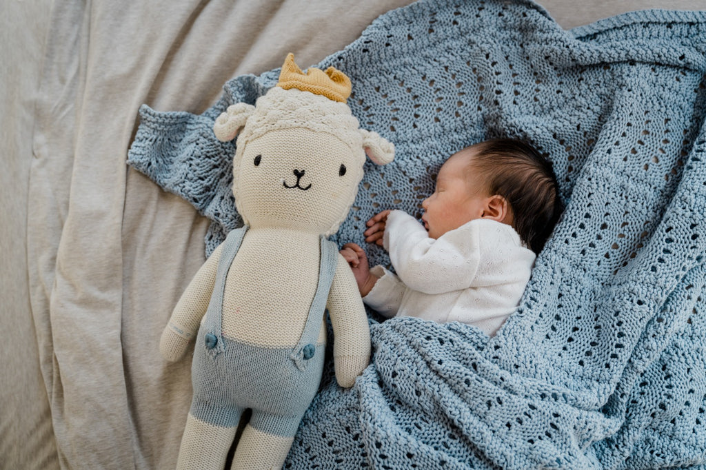 Photo of baby with a big plush toy