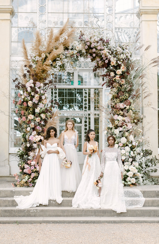 all for love archway wedding flowers bride