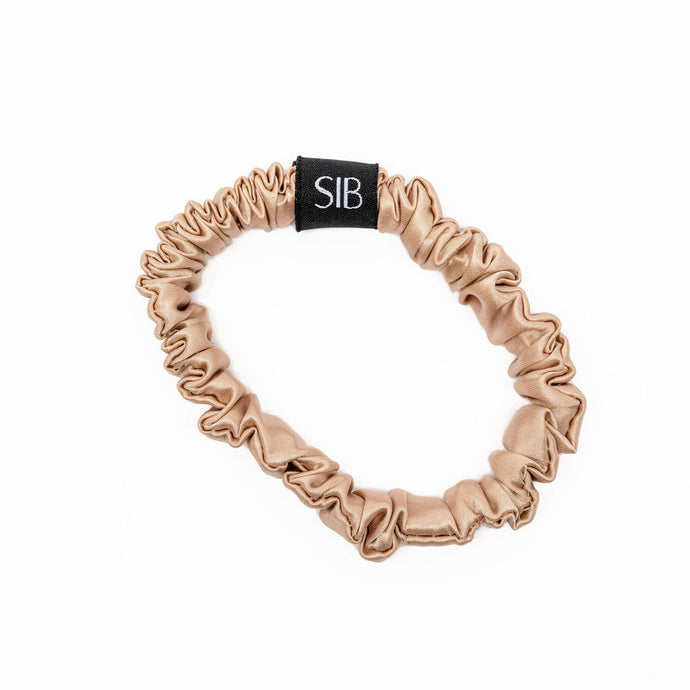 Sleep IN Beauty champagne skinny scrunchie.