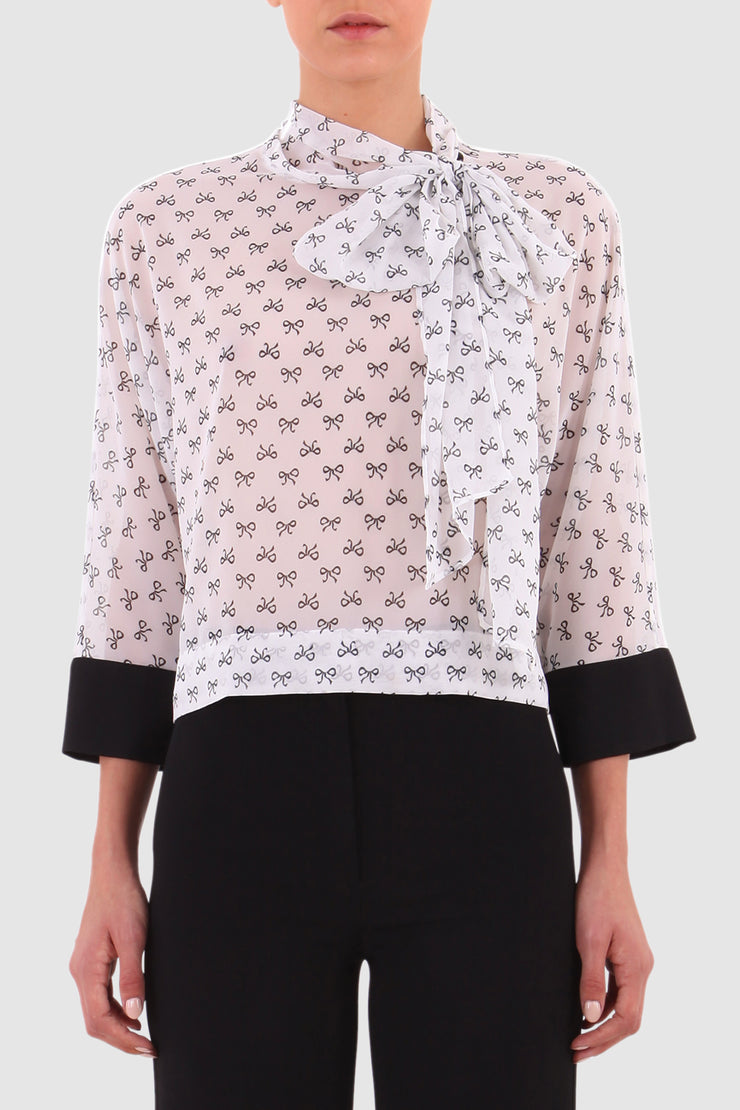Semi-transparent printed pussy-bow blouse