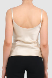 Silk singlet paired with asymmetric skirt