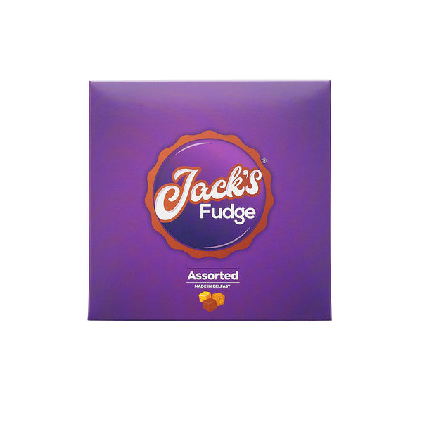 Purple square gift box of Jack's Assorted Fudge. In the middle is the Jack's Fudge logo with 'Assorted' written underneath in white writing. A small picture of three cubes of fudge in different shades of brown is below.