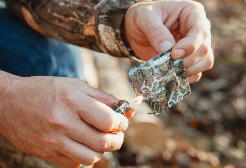 Realtree Fire Starters being used on outing trip wearing hunting camouflage