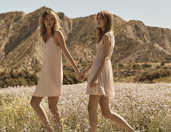 two girls in dresses in nature