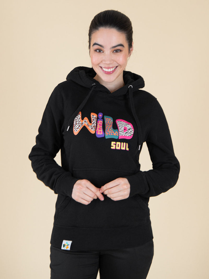 Woman wearing an organic cotton black hoodie with print