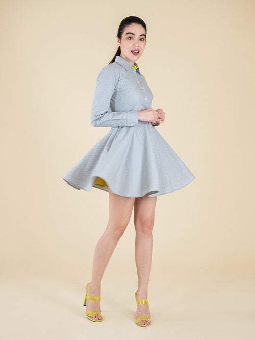 Frontshot of a grey sustainable dress