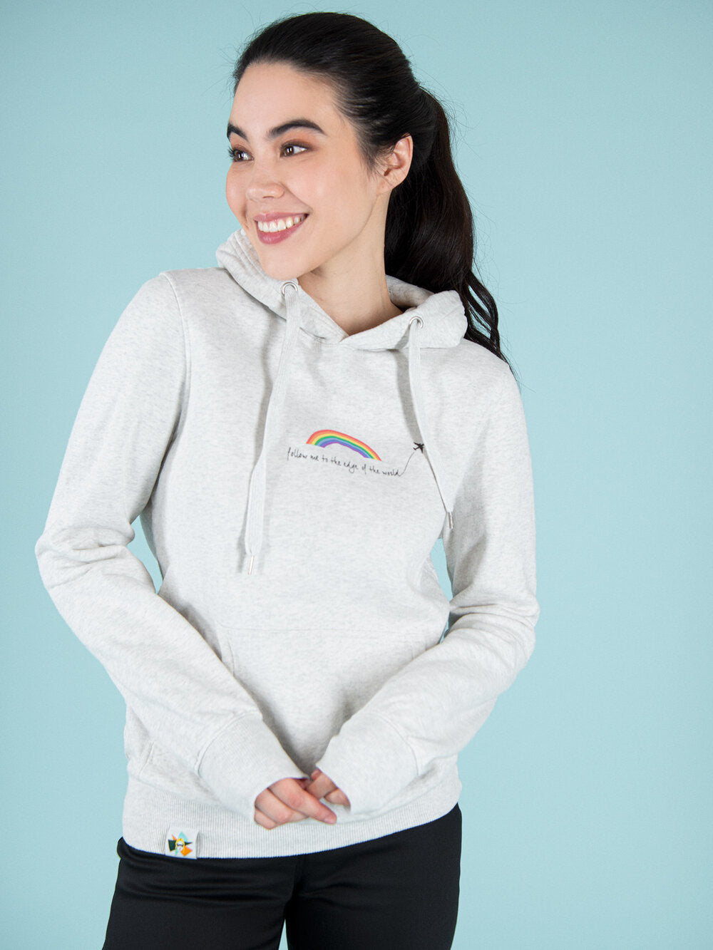 Woman wearing unisex grey organic cotton hoodie with print