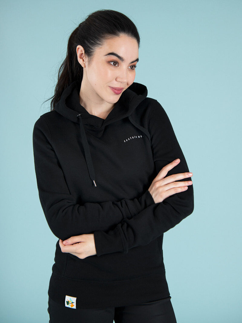 Woman wearing a cosy, black, organic cotton hoodie