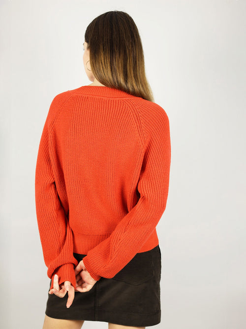 The tomato red organic sweater has comfortable fit and crew neck. Long sleeves and warm knit.