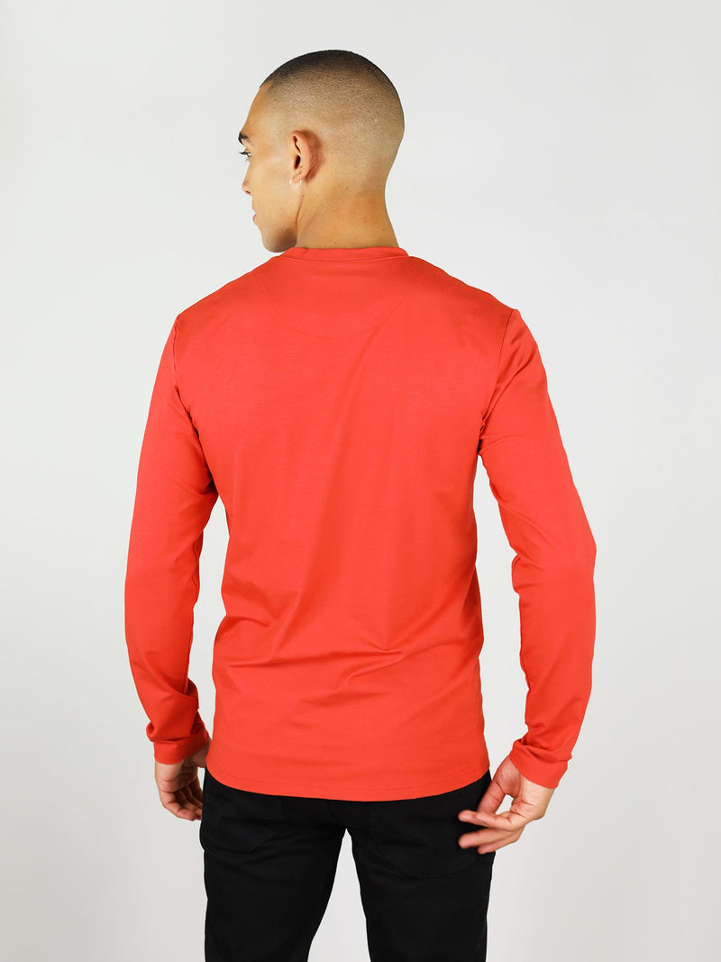 Back shot of the red men's long-sleeve tee. Made from heavy-weight material to keep you warm, crew neck and regular fit.