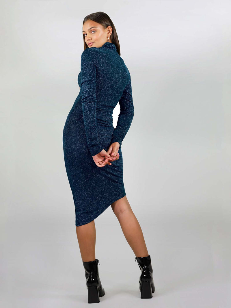The midi new year's dress has body con fit, and stretchy fabric to give you the perfect fit you want. Long sleeve and low turtleneck. It had asymmetric design and comes in sparking teal colour.