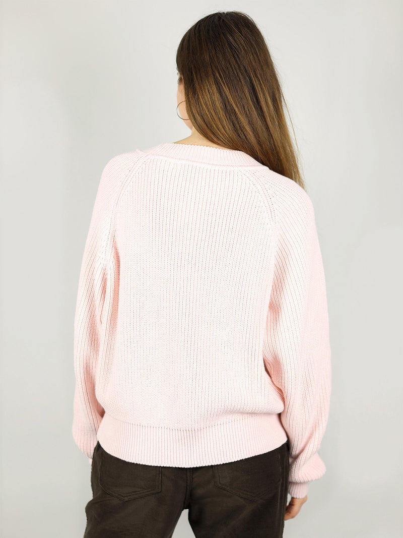 Back shot of the misty pink organic sweater. It has crew neck and long sleeve and it is slightly oversized fit.