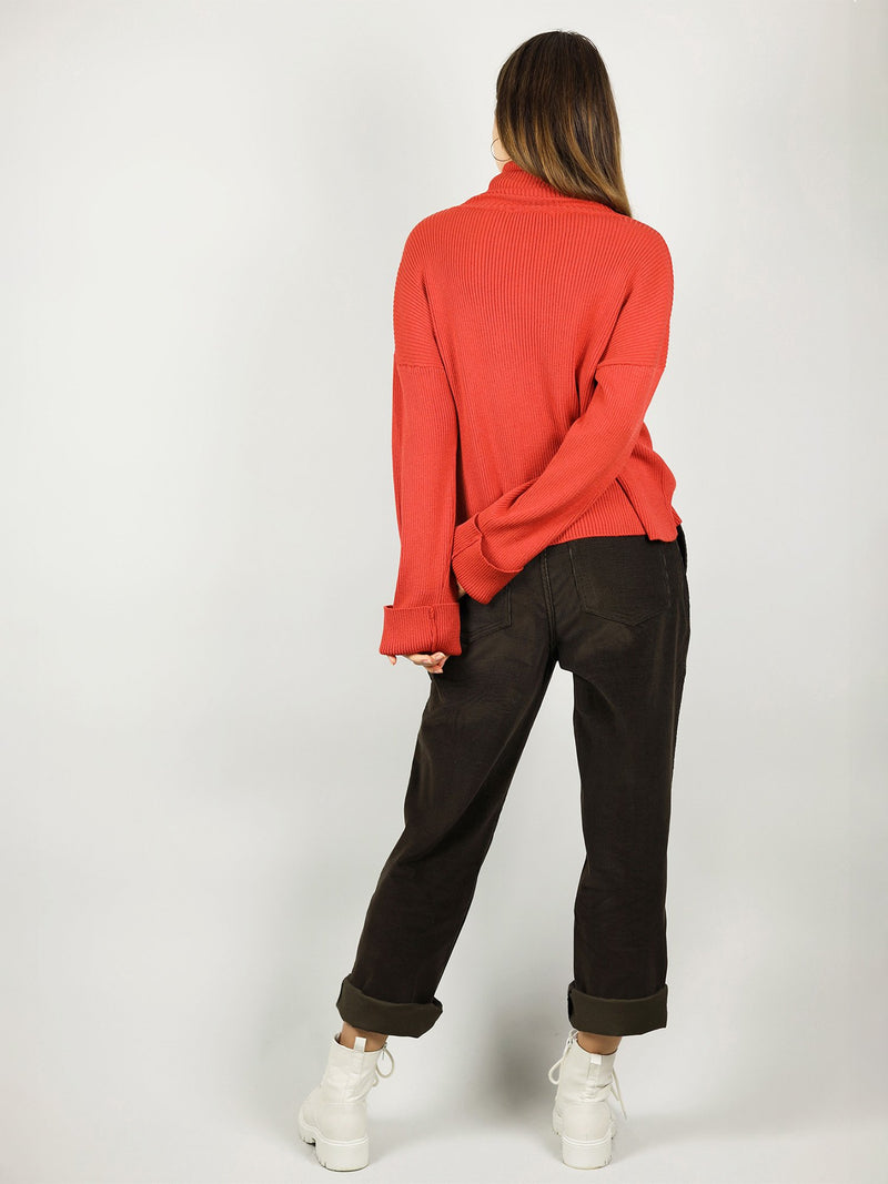 Loose fit and bright red colour, the organic cotton turtleneck has hips length and extra long sleeves. It also has extra long roll neck pullover for warmth.