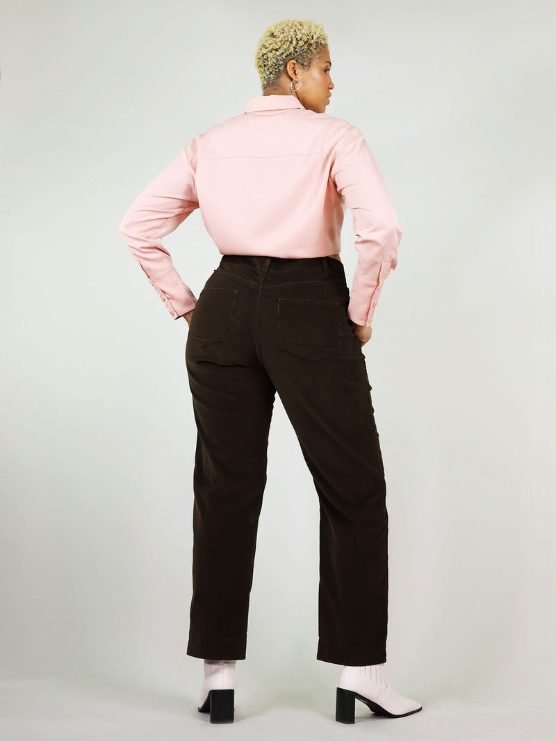 Classic black corduroy trousers, back view. Loose fit, but high waits, so gives a nice waist. Straight leg fit and ankle length with large pack pockets.