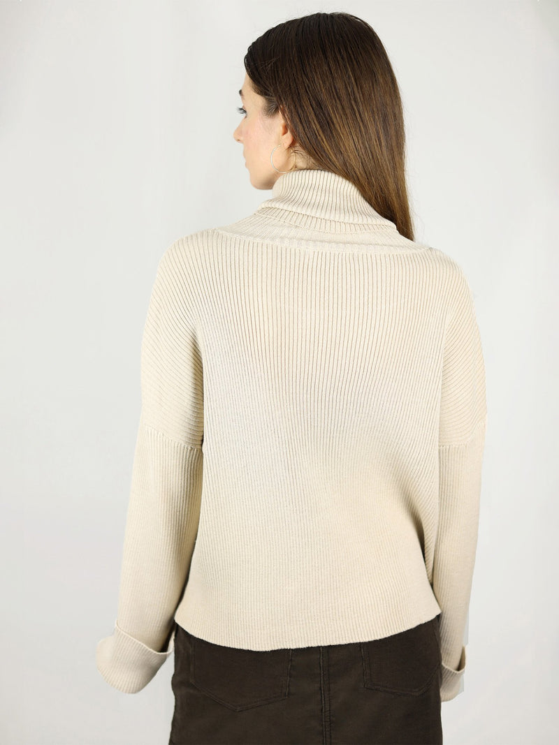 The beige turtle neck has comfortable fit as it is made from 100% organic cotton. Slightly loose fit and hips length. Extra long sleeves and long roll neck pullover.