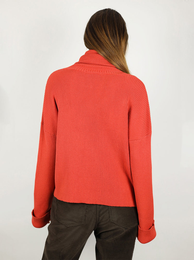 Bright red colour and slightly loose fit, the turtleneck is perfect for winter time. It has extra long sleeves, long roll neck pullover and hips length.