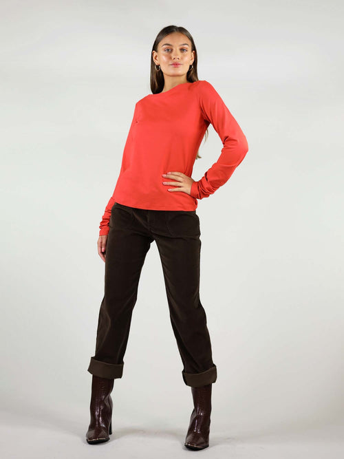 Fired red Sunday blouse has round neck and it is a heavy-weight top. Extra long sleeves for comfort all day.