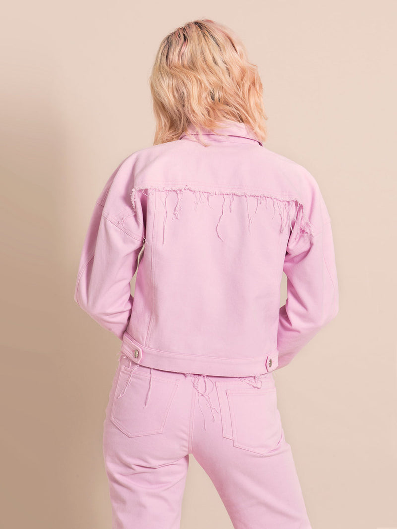 Backshot of a light pink upcycled jacket with frayed elements
