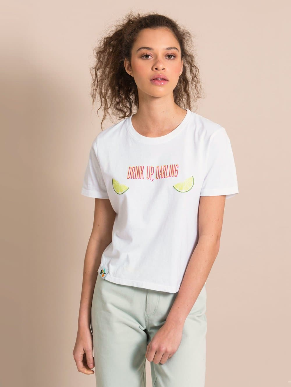 Woman wearing a white sustainable recycled cotton tee with print and light blue jeans
