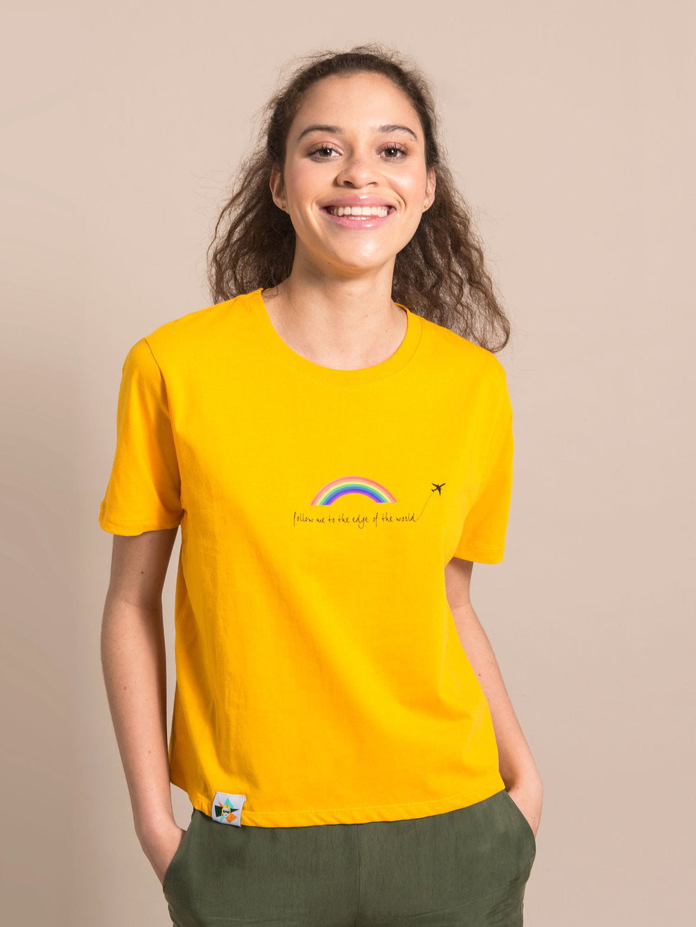Woman wearing a yellow organic cotton tee with print