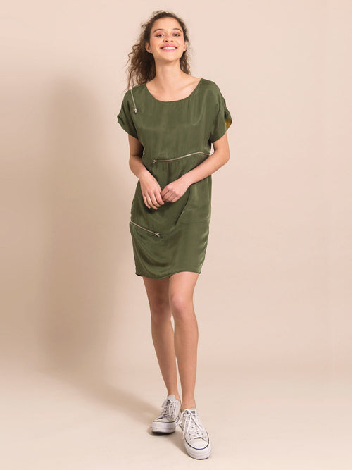 Frontshot of a woman wearing a military green above-the-knee dress with three closed zippers