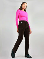 Full body shot of size xs, classic black corduroy trousers. 100% organic cotton with loose fit and high waist. Straight leg, large side pockets and ankle length.
