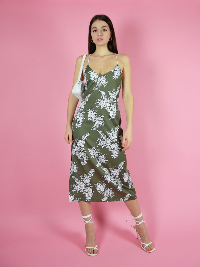 Frontshot of blonde gone rogue's green midi slip dress with thin, adjustable shoulder straps.