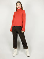 The red turtleneck has hips length and slightly loose, comfortable fit. Extra long sleeves for added warmth as well as long roll neck pullover.