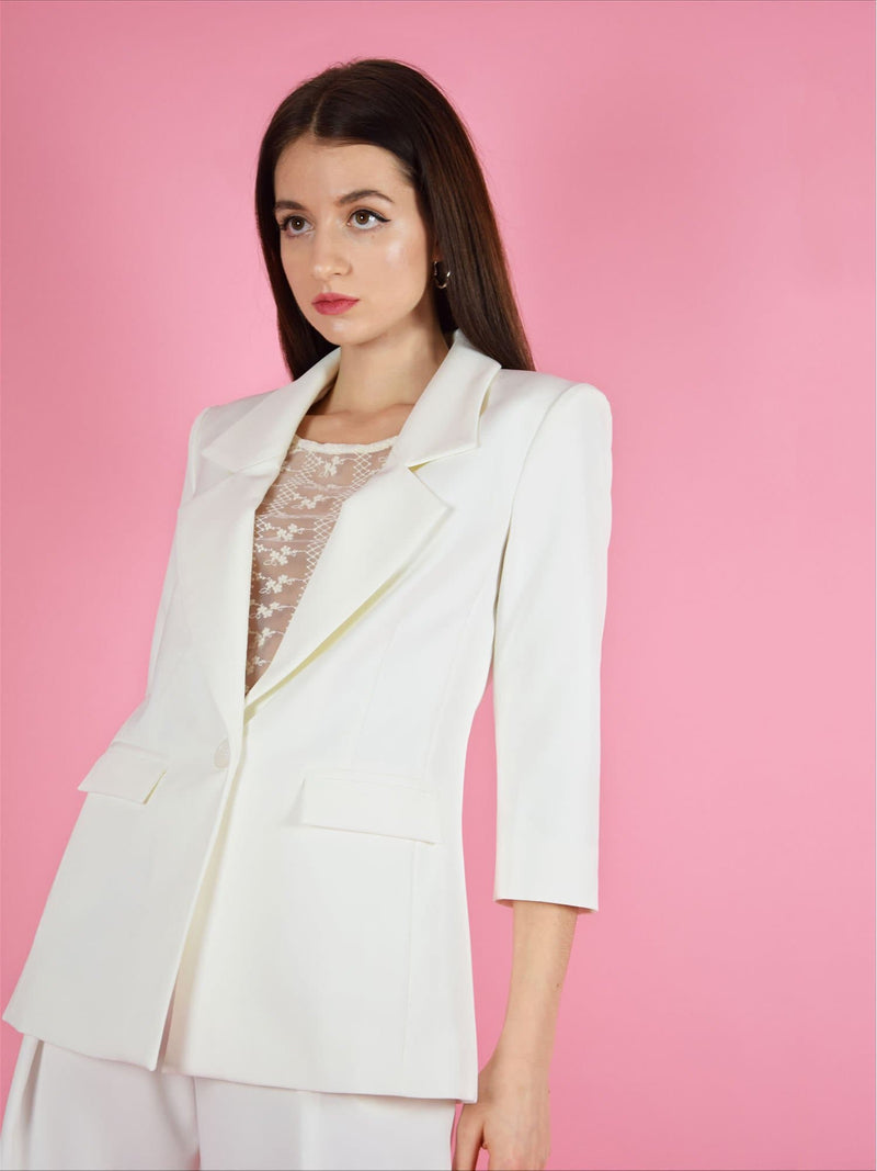 Sideshot of the girlboss white sustainable longline blazer. Designed by blonde gone rogue.