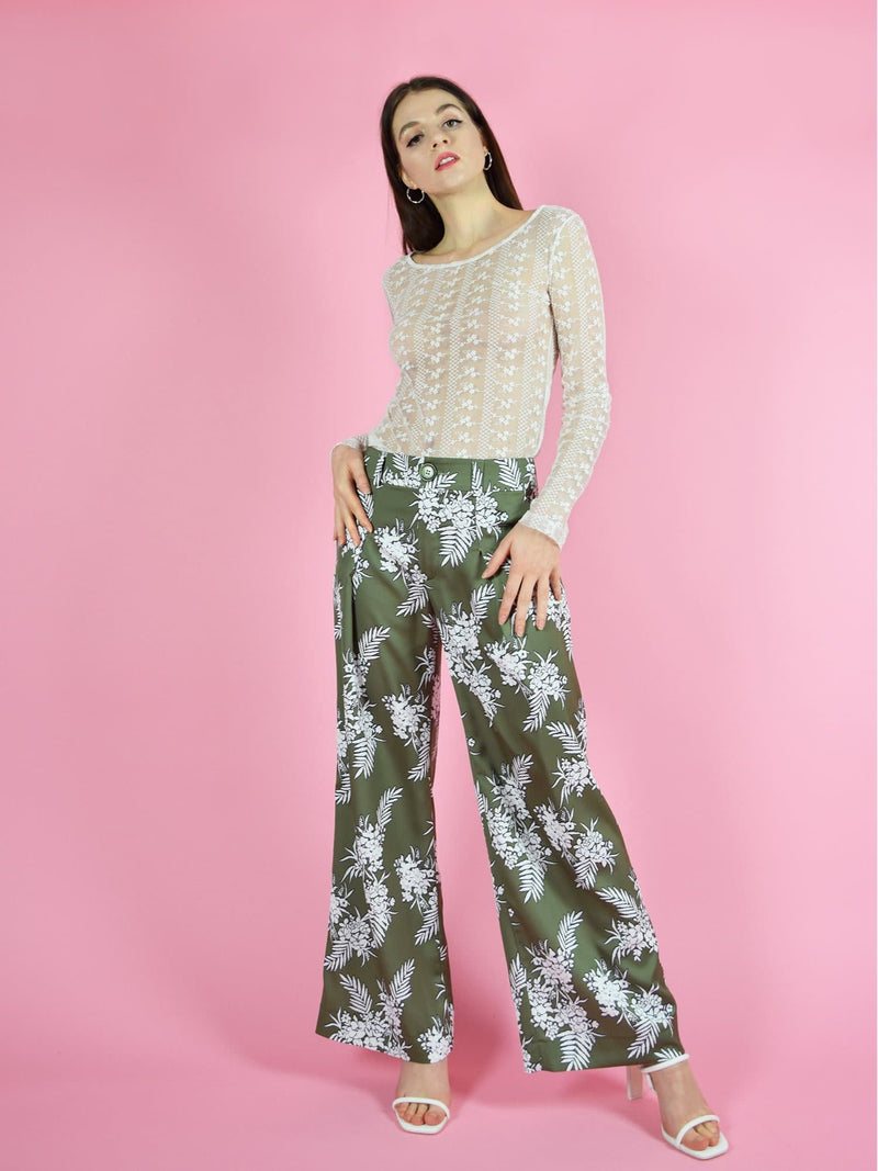 blonde gone rogue's girlboss green sustainable trousers have a wide leg, high-waist design. The pants are made from a beautiful, silky green fabric with white floral print. Paired with the daily long sleeve lace top.
