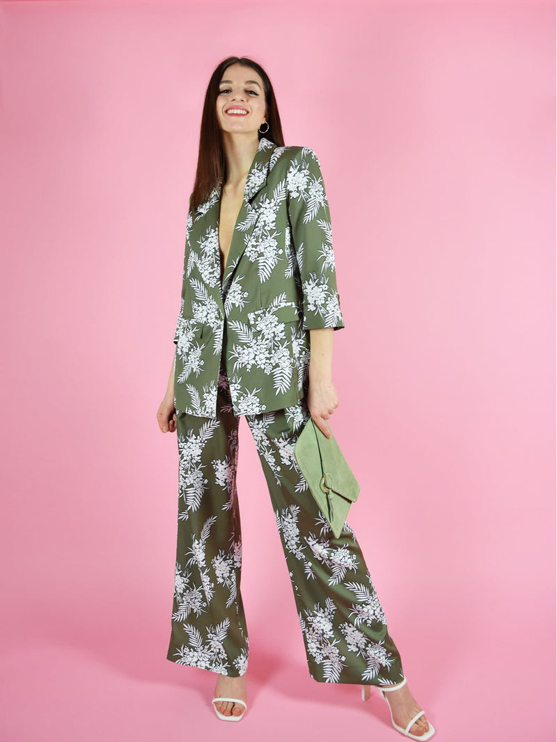 Frontshot of the girlboss trouser suit by blonde gone rogue. The pant suit is green with white floral print.