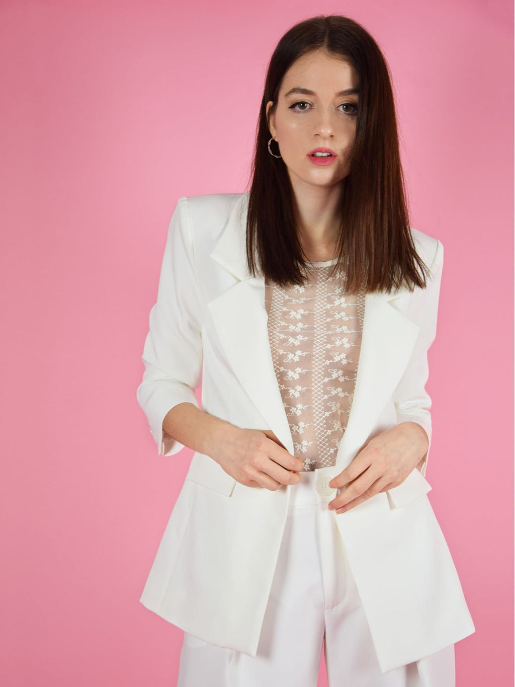 blonde gone rogue's girlboss sustainable longline blazer in white. It pairs perfectly with the girlboss wide leg trousers for a pant suit. Perfect outfit for weddings guests and formal dinner attendees.