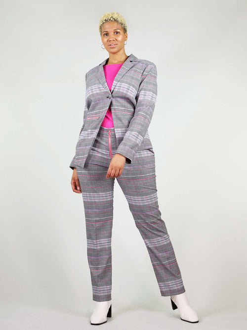 The revivify blazer in pink and grey is button fastening and boxy fit. It has asymmetric design and colourful details.