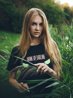 Woman in nature wearing a black sustainable recycled cotton tee with print