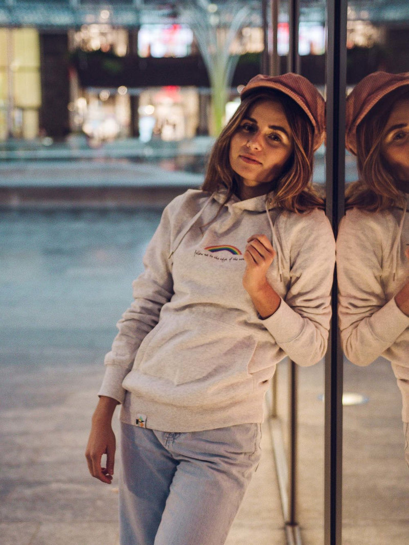 Woman on the street wearing sustainable grey hoodie with print