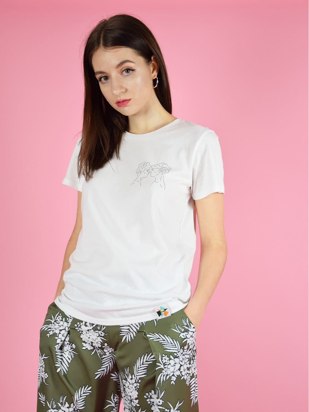 Lover's tee in white. The t-shirt features a subtle graphic print on the chest of two people about to kiss and a branded woven label on the hem.