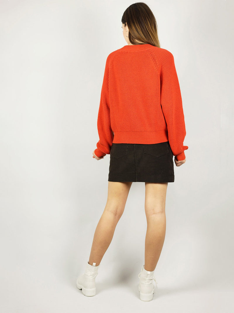 The organic sweater comes in bright red tomato. Comfortable fit as it is slightly oversized and also has crew neck.