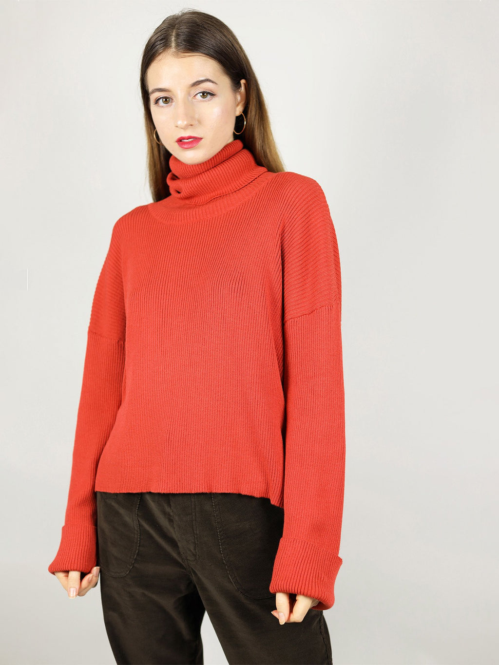 Made from 100% organic cotton, the red turteneck is very comfortable with loose fit. Some add ons include extra long roll neck pull over and long sleeves.