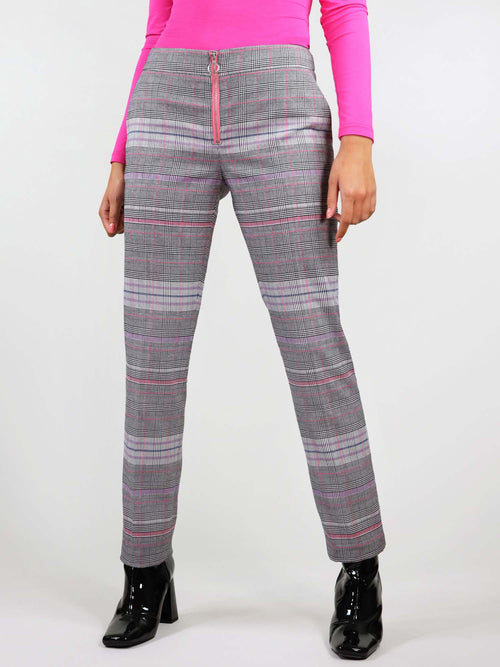 The revivify trousers have bright pink details and pink and grey checker fabric. They have two slant pockets and pink metal zip with ring puller at the front.