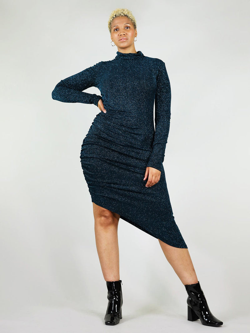 Full body, front view of the sparking teal midi new year's dress in size XL. Low turtleneck and asymmetric design that gathers on the side. Tight, body fit con and long sleeves.