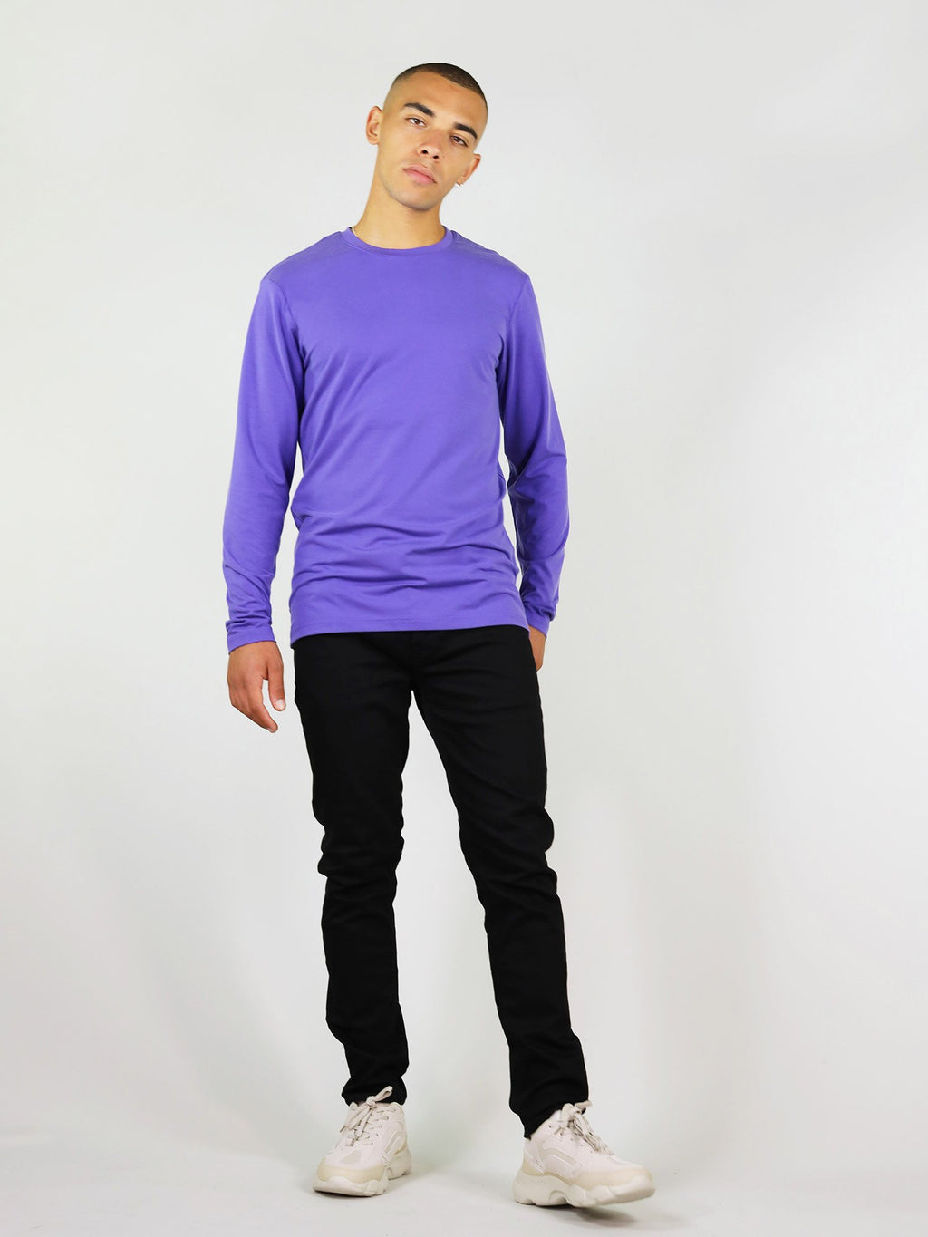 Full body shot of the men's long sleeve tee in purple. Made from heavy weight material, guaranteed to keep you warm. Regular fit and crew neck.
