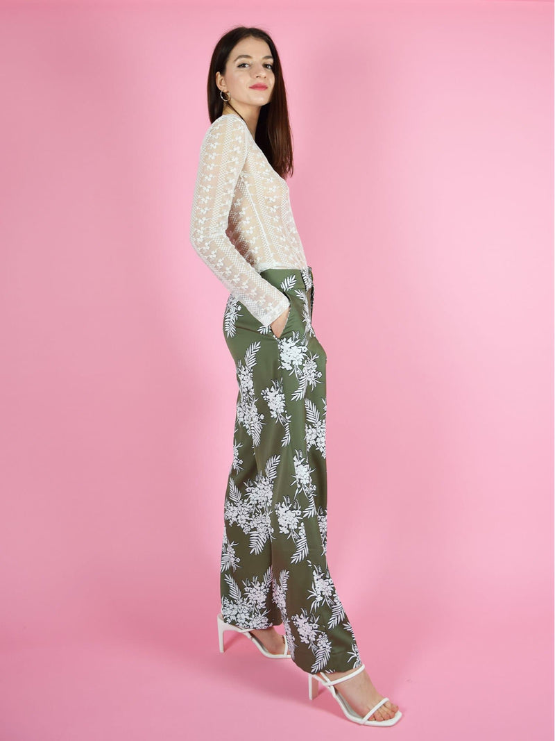 Side shot of blonde gone rogue's daily long sleeve lace top and girlboss wide leg sustainable trousers in green.
