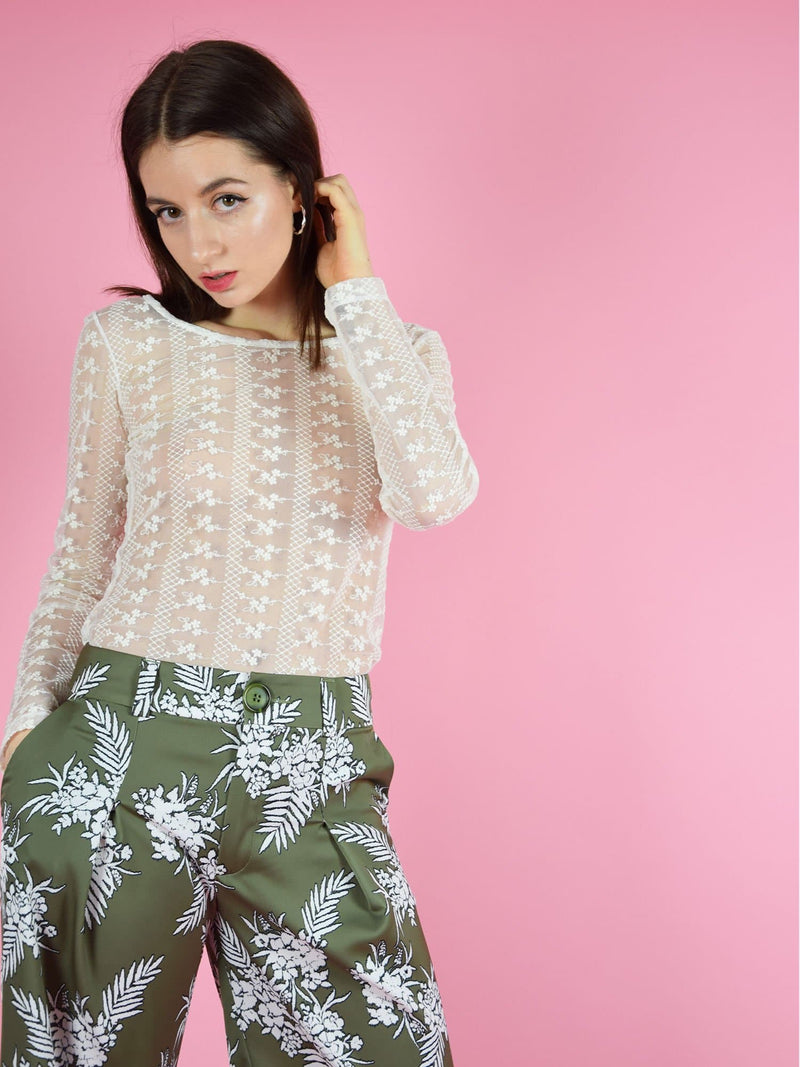 blonde gone rogue's daisy white lace long-sleeve op and the sustainable girlboss trousers in green with floral print.