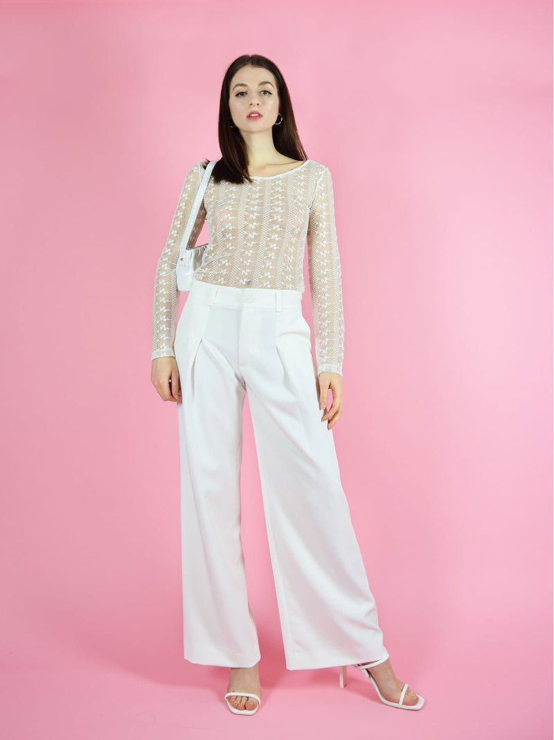 Frontshot of blonde gone rogue's daisy long-sleeve top and girlboss trousers in wide. The pants have a high-waist, wide leg design.