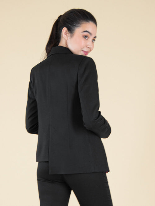 Backshot of a woman wearing a black office blazer